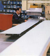 Man using Metal Stamping Machine